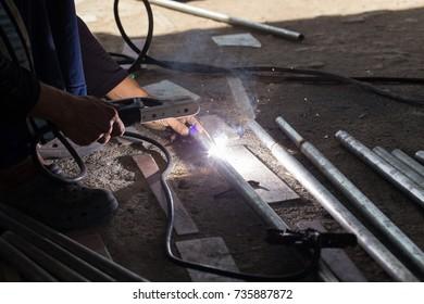 Welded steel by a technician.