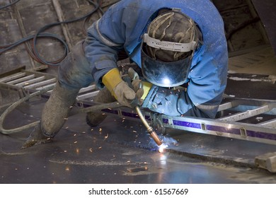 The welder behind work