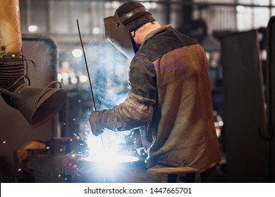 welder during operation.sparks from welding