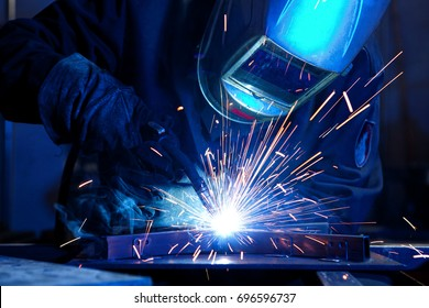 Welder erecting technical steel. Industrial steel welder in factory technical