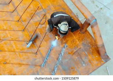 Welder at his work. A welder is cooking metal.