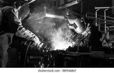 welder Industrial automotive part in factory black white