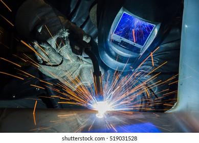 welder Industrial automotive part in factory Welder at work welding splatter