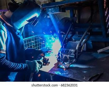 welder Industrial motorcycle part in welding factory