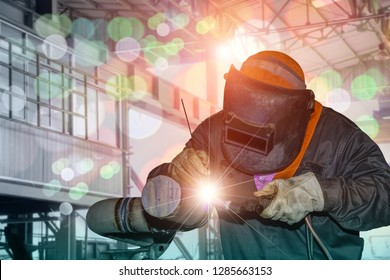 welder man, Industrial Worker at the factory welding process by Tig gas argon close up with protective equipment mask, PPE marks welder on bokeh background.