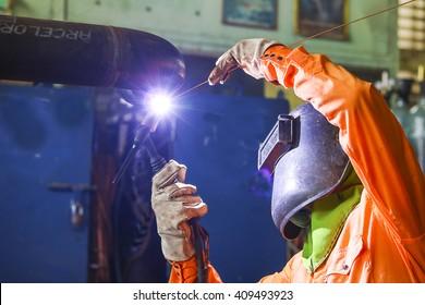 Welder man Tig welding in piping shop