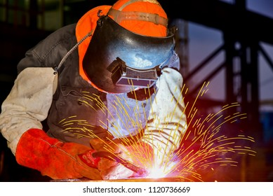 welder man worker success industry by Mig weld process ware equipment protective for safe on black tone background