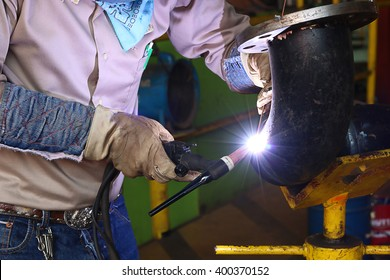 welder man in workshop,tig welder