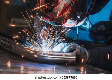 Welder in mask welding metal and sparks metal close. spark, protective, welder, tool, flash, welding, skill, equipment, protection, industrial, safety, metalwork, mask, gloves, sparks welding, sparks