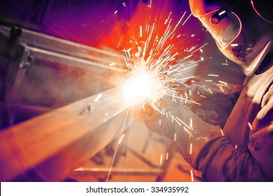 Welder in the mask at work