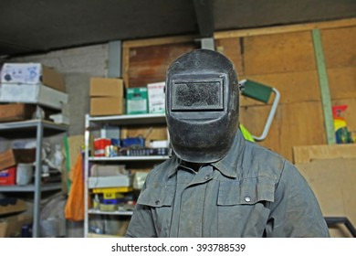 Welder in the mask in the workshop