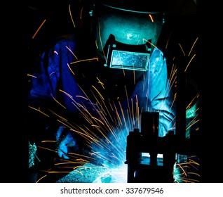 Welder movement Industrial automotive part in factory