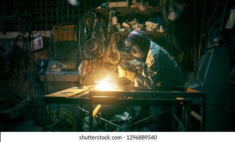 Welder on steel structure in factory