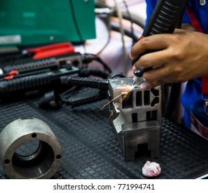 Welder operate handheld laser welding