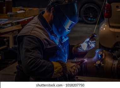 Welder at orbital welding machine