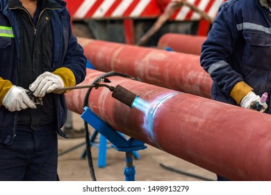 The welder is preheating to pipeline before welding. The phenomenon of heating the joint in the weld zone before the commencement of welding procedure is known as pre-heating.