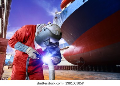 Welder process by Tig argon gas, craftsman, electing technical steel Industrial in factory with equipment protective leather gloves and mask at floating dock in shipyard and side ship background.
