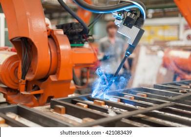 Welder robot operate in steel factory