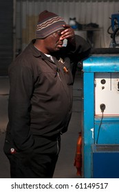 Welder standing with hand on forehead and sleeping