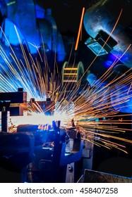 Welder is welding automotive part