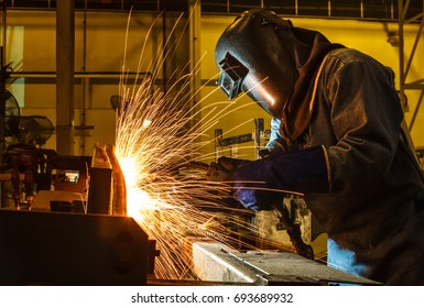 welder, welding automotive part in a car factory