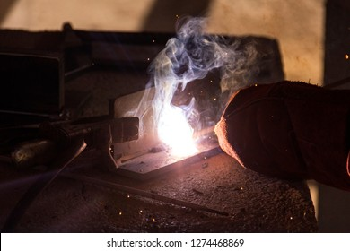 The welder is welding with covered electrode. Covered electrodes are used extensively in shielded metal arc welding and are a major factor in that method's popularity.