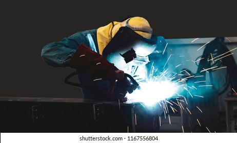 Welder is welding flux cored arc welding ,Industrial welding part in Oil and Gas or Petrochemical,Copy space