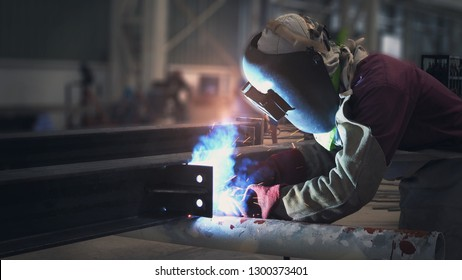 Welder is welding flux cored arc welding  Industrial welding part in Oil and Gas or Petrochemical ,Copy space for you text.