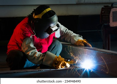 Welder welding a large piece in the factory