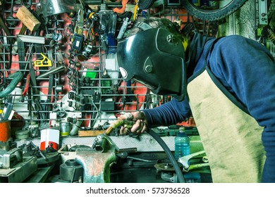 welder, welding mask, working in the garage