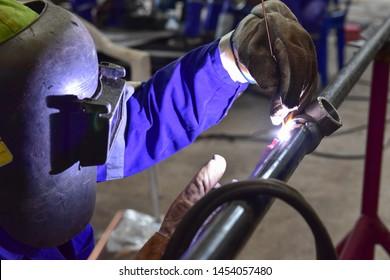 The welder is welding the pipeline with Tungsten Inert Gas Welding process (TIG).