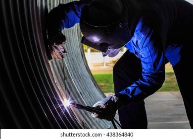 Welder welding stainless steel with gas tungsten arc welding process