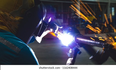 Welder is welding Tig ,Industrial welding part in Oil and Gas or Petrochemical.