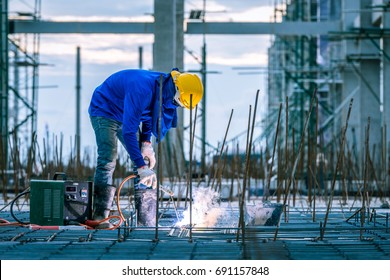 welder welding worker in the construction site