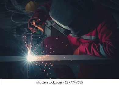 Welder at work for close-up work, joining parts with welding.