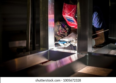 Welder at work, using a Tig handle.