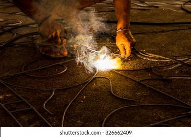 Welder working in a factory
