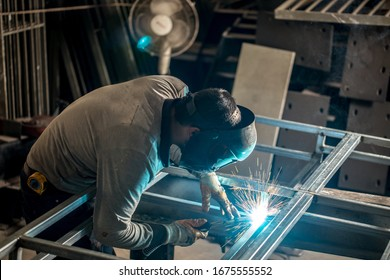 Welder working at the factory made metal and galvanized pipe.