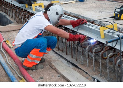 Welder working on a construction site - a natural scenery