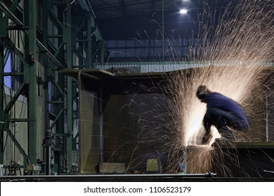 welder is working on metal industry with body protections