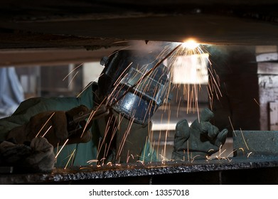 a welder working at shipyard during day