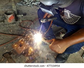 welder working in shrimp farm  welding steel, Thailand.