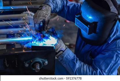 Welder working a welding metal -Welders and Flamecutters