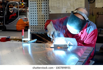 welder works in the metall industry - portrait