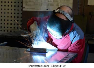 welder works in the metall industry - portrait