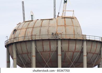 Welders building new water storage tank