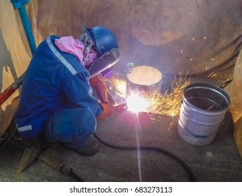 Welders on the pipe repairs. Welding is a fabrication or sculptural process that joins materials, usually metals or thermoplastics, by causing fusion.