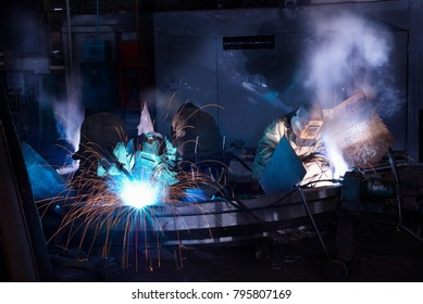 Welders working at the factory