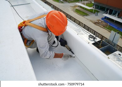 Welding canvas roof sheet by technician for seal the gutter drainage