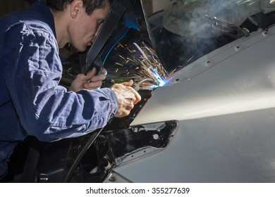 Welding the car body after the accident